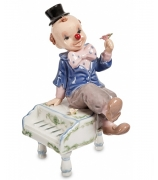 Фарфоровая статуэтка «Клоун на рояле»