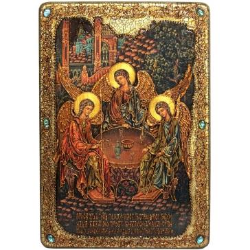 Икона «Троица» на доске с самоцветами в шкатулке.
