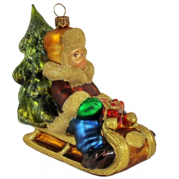 Стеклянная ёлочная игрушка «Мальчик в санях»
